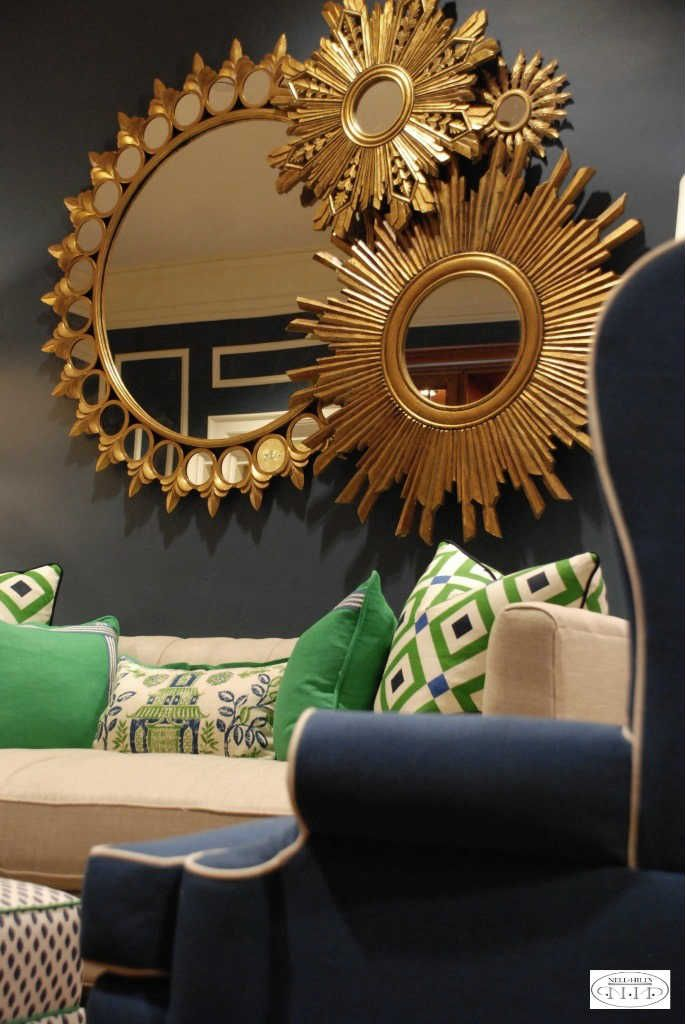 Dramatic colors make this room at the Pi Beta Phi house sing. Nell Hill's designers combined blues, bright greens and whites in a mix of fun fabrics. The montage of gold sunburst mirrors finishes the room perfectly.