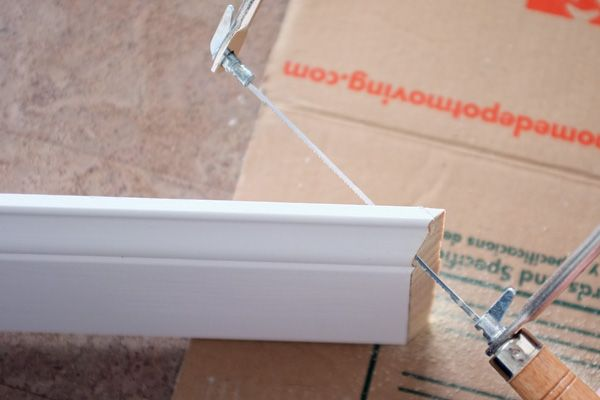 use a coping saw to better merge floor boards