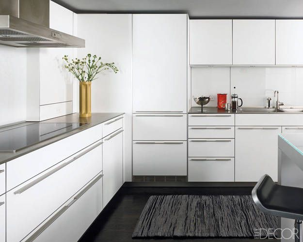 The Bulthaup kitchen includes white-laminate cabinetry and stainless-steel countertops.