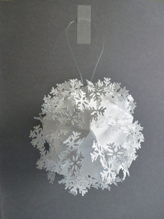 Tyvek paper bauble/Christmas decoration with cut out linking snowflakes