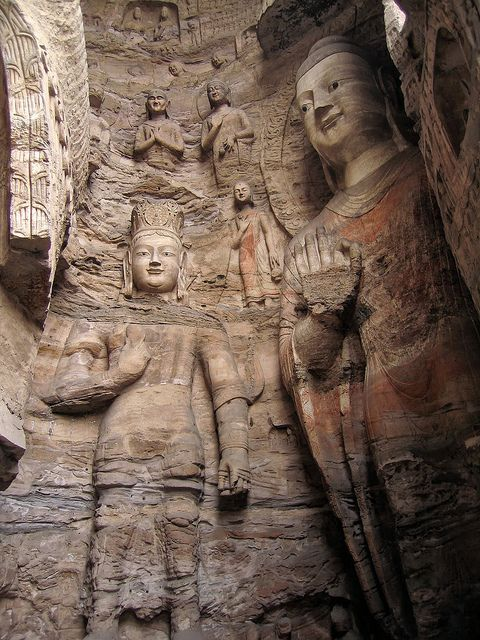 Yungang Grottoes - Datong, Shanxi, China.  The site is an outstanding example of Chinese stone carvings from the 5th and 6th centuries.  All together the site is composed of 252 grottoes with more than 51,000 Buddha statues and statuettes.  by Around the World in 480 Days