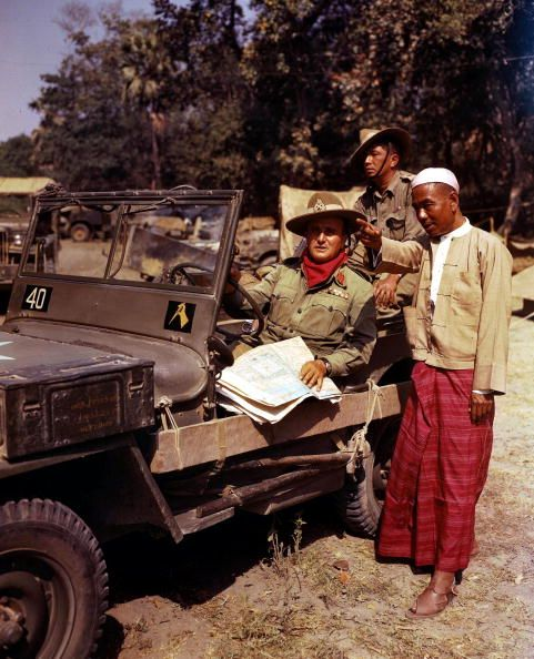 World War Two Burma Asia March 1945 A Burmese official points out landmarks to Major General Thomas Wynford Rees commander of the 19th Indian army...