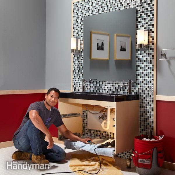 transform your bathroom in a weekend with a glass tile wall, a sleek new vanity, two modern light fixtures and one very large mirror – then tie it all together with natural birch trim.