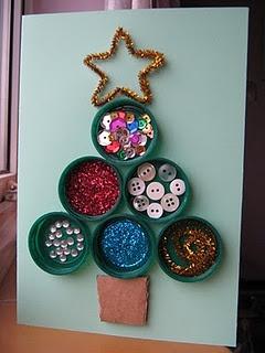 Christmas tree: Construction paper, green bottle caps, cardboard, pipecleaner, buttons, rhinestones, glitter, glue, scissors