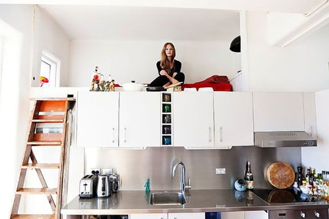 I've seen loft sleeping before but this is the first one above the kitchen cabinets!! The 18 Most Beautiful Lofts You've Ever Seen via Brit + Co.