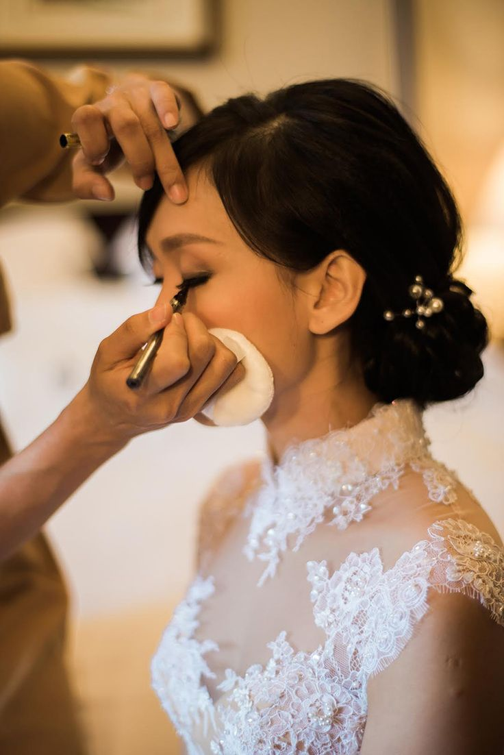 Bride in beaded illusion cheongsam wedding gown with elegant low updo with flowers // Sean and Kiko's Wedding at Eastern and Oriental Hotel