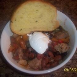 This is a great slow cooker chili recipe with ground beef, carrots, celery, and beans that you can adjust to your tastes.