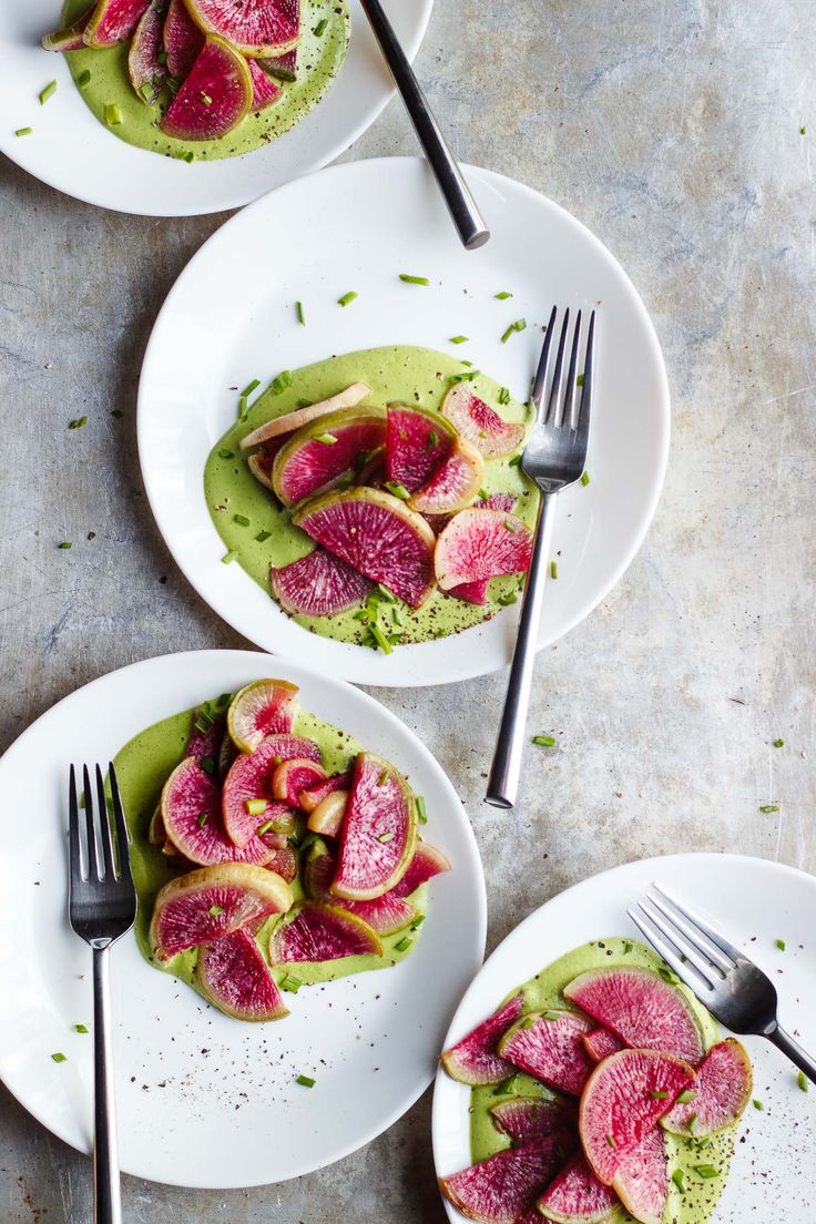 Roasted Watermelon Radishes with Herbed Tahini Sauce   Roasted watermelon radishes served with herbed tahini sauce from Dishing up the Dirt. Roasted radishes magically transform as a great spring dish.