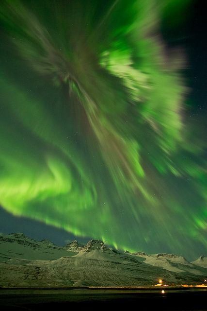 An aurora on March 8, 2012 shimmering over snow-covered mountains in Faskrudsfjordur, Iceland. Image courtesy of Jónína Óskarsdóttir.