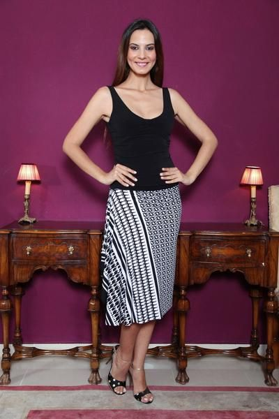 Black and white tango skirt with side draping #condiva #tangoskirt #argentinetango #tangoclothes #milongaskirt
