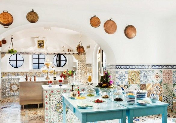 Positano, Italy - The clean whites and vivacious hand-painted tile work at Villa Treville are deliciously inspired. The Positano hotel is an irresistible getaway. Elevated kitchen appliances and accessories bring whimsy and decadence to mealtime.