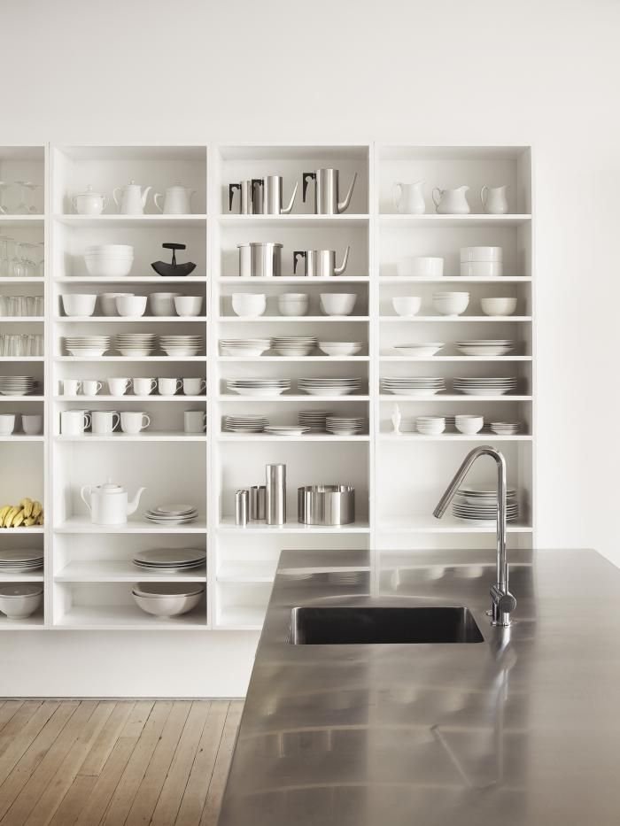 White Loft by Qb3 in Philadelphia, smart storage bookshelves/display cases/room dividers, bleached maple floors, stainless steel kitchen counter, Aquabrass faucet, Remodelista