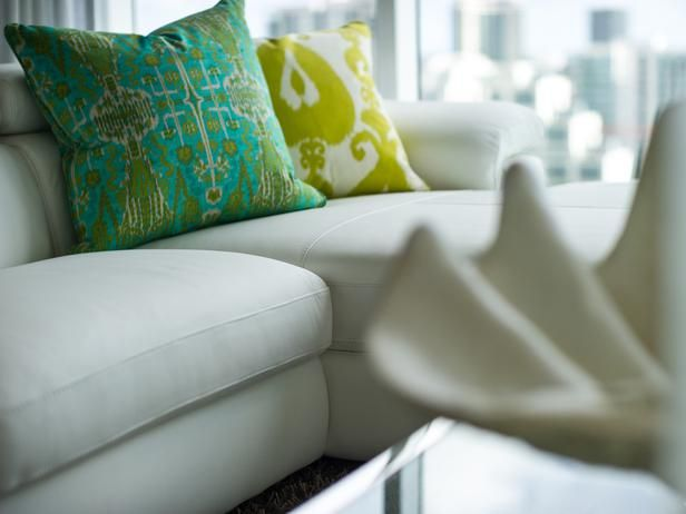 Throw pillows break up an all-white palette and give some additional interest to the sectional.: Interior Design, Living Rooms, Urban Oasis, Hgtv Urban, Living Room Pictures, Sofa Pillows Color, Oasis 2012, All White Palette, Color Combination