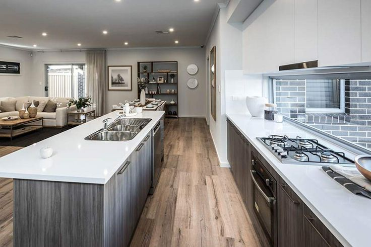 A modern kitchen makes cooking time a breeze. #weeksbuildinggroup #newhome #homedesign