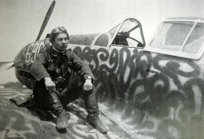 Kamikaze pilot Ryōji Uehara on the wing and next to the tail of a Kawasaki Ki-61 Hien. He was a member of the 56th Shinmu squadron (第56振武隊) of the IJA Air Corps when he carried out his final mission against the US carrier fleet near Kadena, Okinawa Prefecture on 11 May 1945. He was 22 years old. His letter, written to his parents the night before his final mission, was published after the war and it is still regarded as a masterpiece of wartime literary works in Japan.