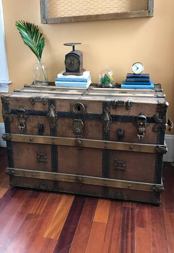Unbelievable statement piece! This absolutely gorgeous 1920s Large Travel Trunk is the perfect piece for your entryway or living room. Measuring at 3ft 2in wide, 2ft 1.5in tall and 1ft 9in deep, this amazing travel piece is the perfect size for an end table, coffee table or entryway