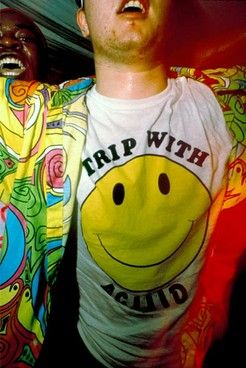 "Smiley face T-shirts, tie-dyed clothing, and psychedelic prints become negatively associated with ""raves"" during the 1990s. Drug use, underage drinking, and prostitution often occurred at these young adult and teenage parties."