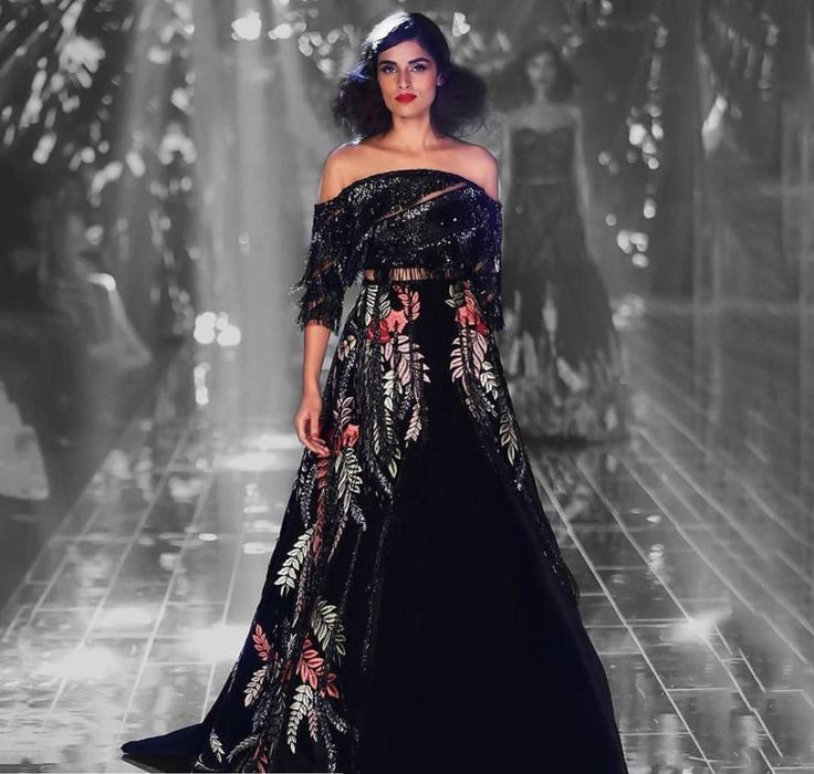 Introducing #TalesOfIndulgence, an amalgamation of bespoke outfits. This floral embroidered dress with a joining cape flows on down the ramp