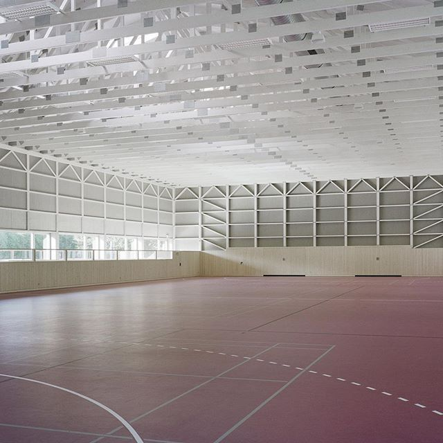 This prefabricated timber sports hall by architect Florian Fischer has a shed-like appearance that references the form and materiality of vernacular agricultural buildings in Austria's Tyrol region. Find out more on dezeen.com/architecture #architecture #sport #wood #Austria  Photograph by  Sebastian Schels of PK-Odessa.
