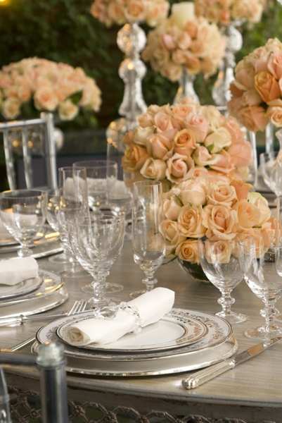 Fancy Table Setting With The Glasses, Plates And Silverware.