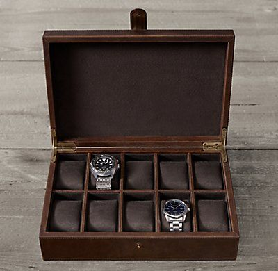 RH's Leather Watch Box: Artisan crafted from premium topstitched leather and lined with soft faux suede, our hinged box is purpose-built to store and protect fine timepieces. Inside you'll find 10 compartments with padded watch supports that can be removed to make room for cufflinks and other accessories.