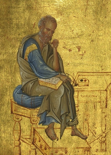 St John the evangelist reading (surrounded by gold)