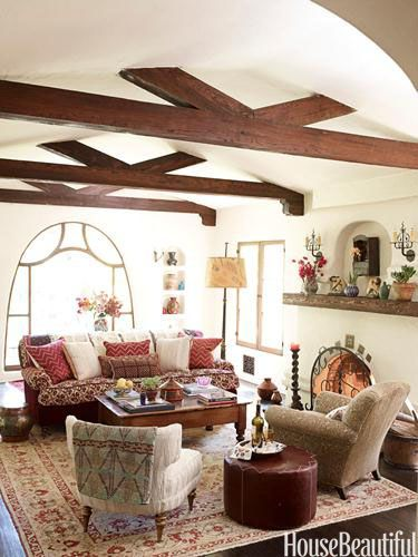 The living room in this renovated 1928 cottage is lightened by colorful textiles and by Porter's Paints' Chalk on the walls. Design: Kathryn M. Ireland