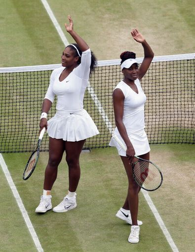 Serena Williams, left, and Venus Williams of the U.S celebrates after beating Julia Goerges of Germany Karolina Pliskova of the Czech Republic in their women's semifinal doubles match on day twelve of the Wimbledon Tennis Championships in London, Friday, July 8, 2016. (AP Photo/Tim Ireland)