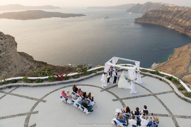 Romantic clif-top wedding by the sea in Santorini!