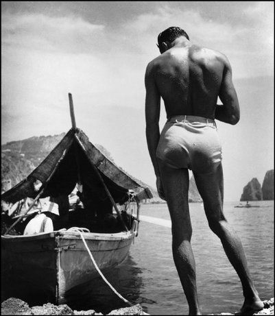 The romance, sensuality, and luminescence of the beach was a favorite subject of Herbert List, one of Magnum's earliest members.  CAPRI, Italy—Fisherman, 1935.  © Herbert List / Magnum Photos