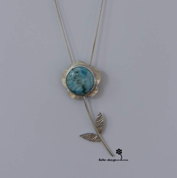 Flower pendant of silver and Larimar stone.