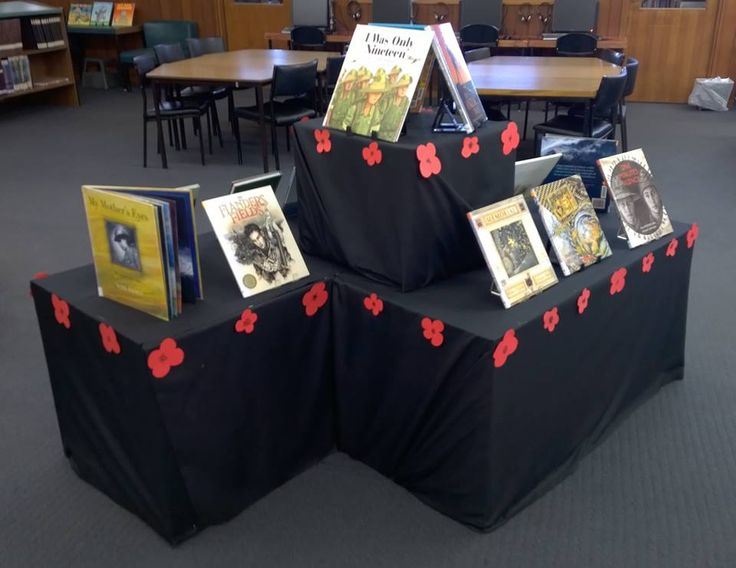 A 'Remembrance Day' book display, with paper poppies.