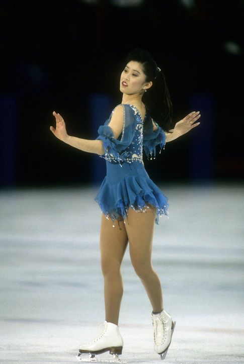 Best Olympic Ice Skating Costume: Kristi Yamaguchi, 1992 The black-and-gold number Kristi wore when she won the gold might be more well-known, but we're partial to this princess-like turquoise chiffon dress she wore earlier in the competition.