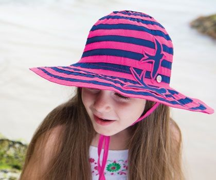 Sundae Wide Brim. This hat has one of the largest brims you will find.It is made from layers ribbon carefully sewn together. it is hot pink and navy with 2 birds on the front.
