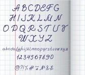 Mano scritto alfabeto su carta al quadrato  stock photography