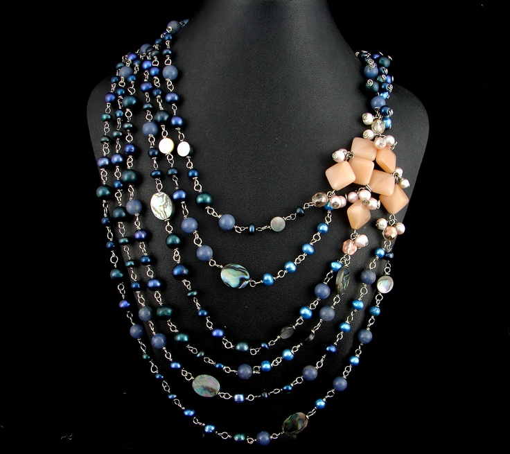 Storm necklace created by my wife.  Inspired by a storm we watched together in the Black Hills.  She's selling it for $149.00