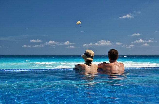 """Cancun, Mexico is great for the couples who will be truly exhausted after their big day. The all-inclusive resorts will pamper honeymooners so they can get plenty of """"us"""" time."""