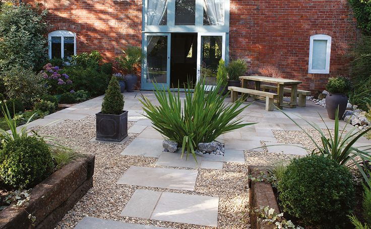 Natural Sandstone Paving in Autumn Green with borders and decorative planting