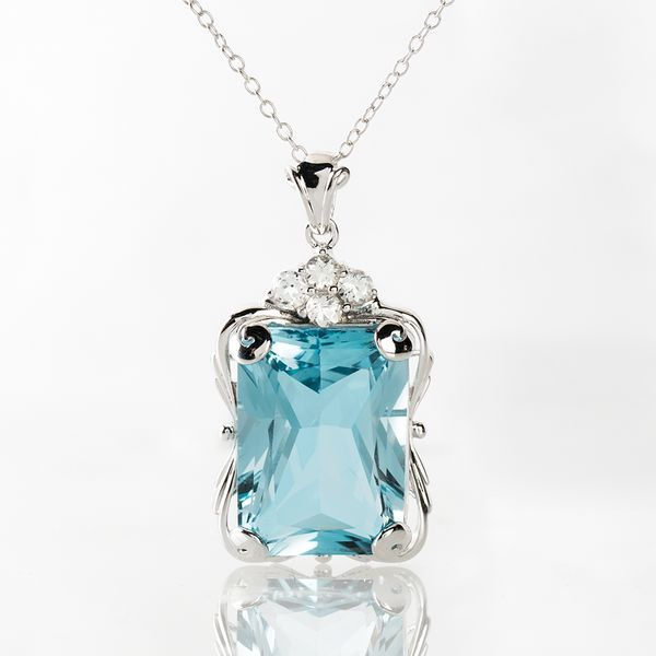 This pendant is the perfect blend of the sky and the ocean, along with fiery brilliance and luster reminiscent of diamonds| We just can't get enough of it! || 14.84ct Rectangular Octagonal Topaz, .37ctw White Topaz Silver Pendant with Chain [Promotional Pin]