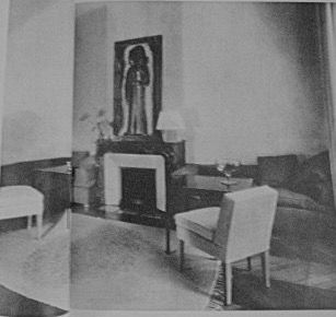 The dining room of Elsa Schiaparelli's apartment on the boulevard Saint Germain in 1931 by Jean-Michel Frank. His design (which illustrated both Schiaparelli's love of colour and her influence with him) was based on the colours of white, yellow, orange, green, and black. White being used for the walls, Tunisian rugs, and the rubberised fabric used for the curtains and the chairs. The divans were done in the same fabric, but in a brilliant green.