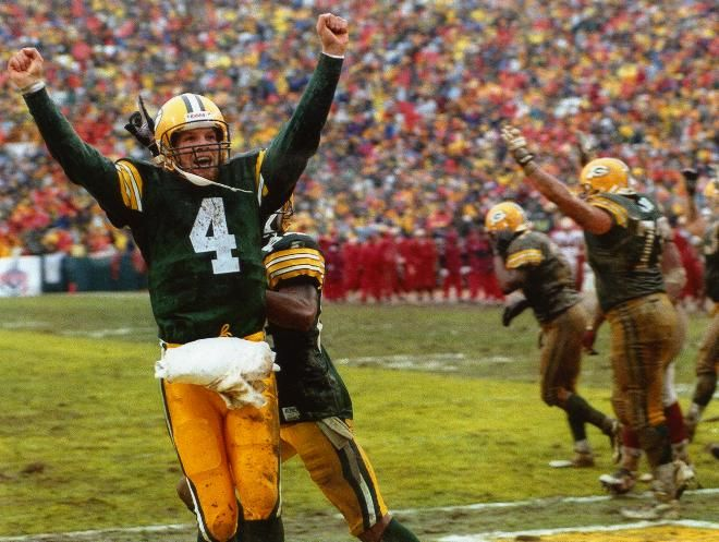 Packers quarterback Brett Favre shows his delight after Edgar Bennett's goal-line fumble was recovered by Antonio Freeman for a touchdown in the third quarter against the Stinking 49ers on Jan. 4, 1997.