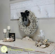 Pages from an old encyclopedia become a beautiful wreath that can easily span seasons and decorating styles!