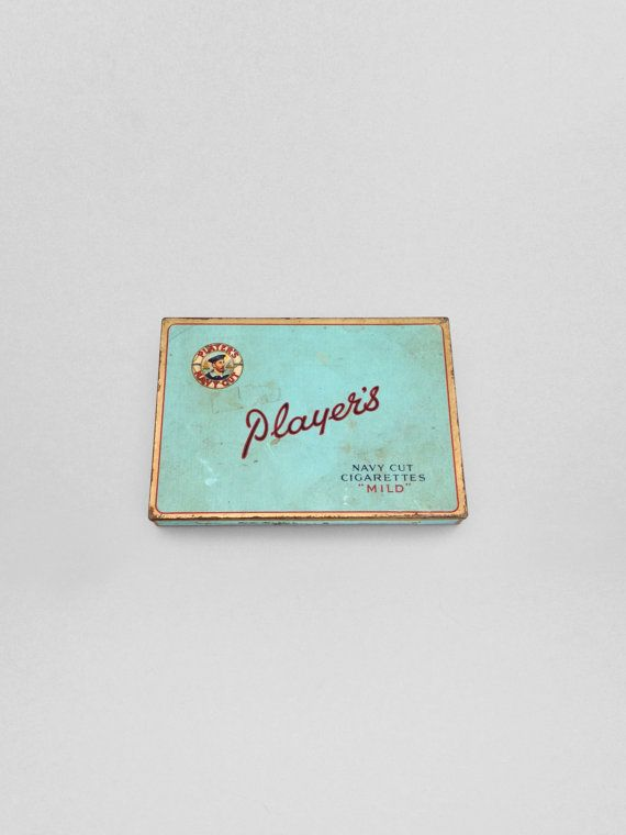 This retro case of Player's mild Navy Cut cigarettes features a beautiful robins egg blue hue with a hold and red trim. Not a smoker? Give a home to your spare change, keys, jewelry, cards, or any other items you might need a sturdy tin for.