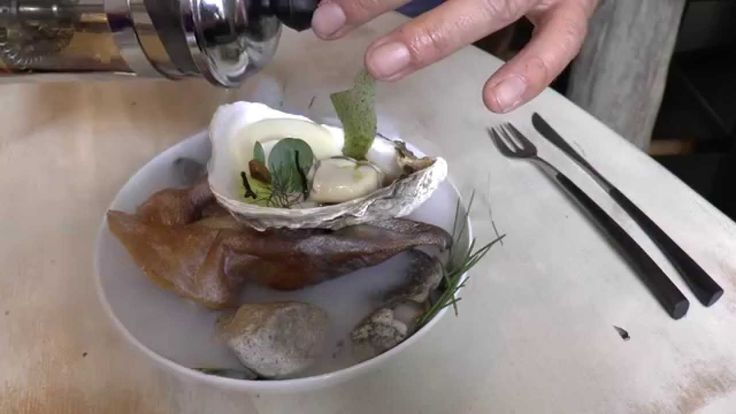 Piet Patron - Huysentruyt prepares a dish with smoked oyster and pig ear at his Michel...