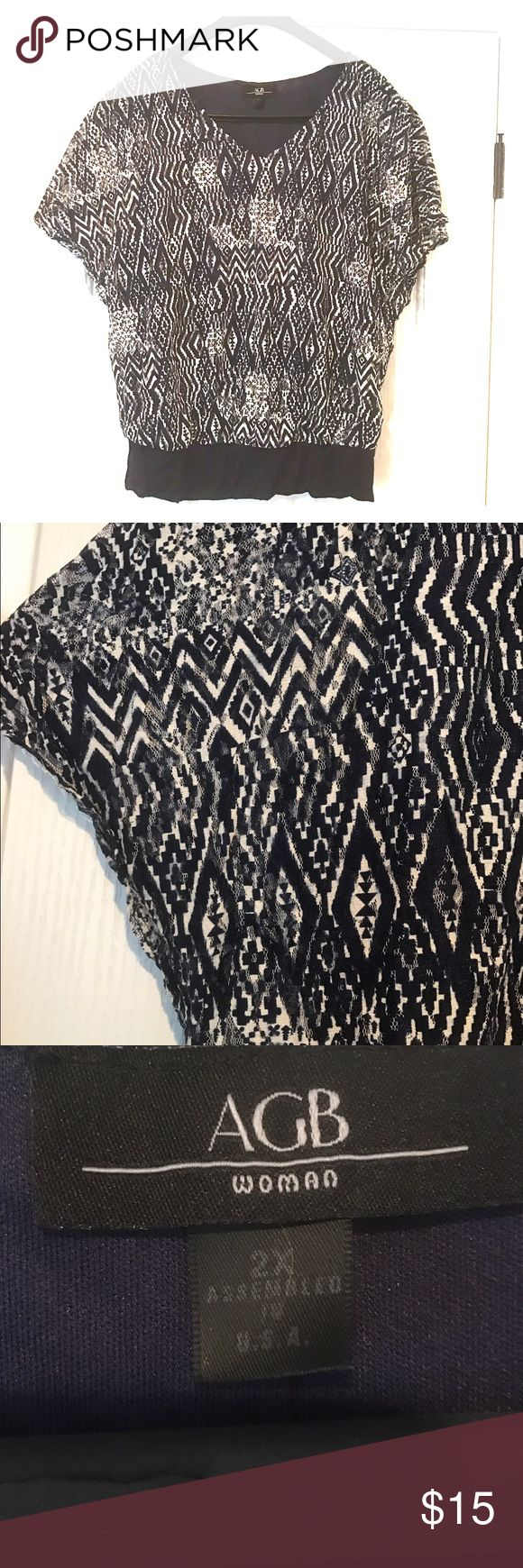 Navy Blue Aztec Print Batwing Banded Bottom Shirt Cut out Aztec print overlay. Batwing sleeves with a banded bottom. AGB Tops Blouses