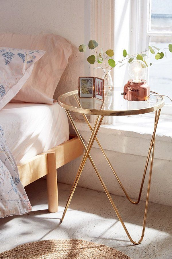 Hollyce Side Table - Rounded glasstop side table with crossing metal legs for a modernminimal finish. Perfect as a night stand, too![ad]