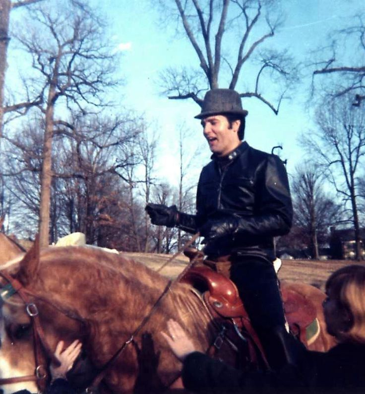 Elvis and Rising Sun. Elvis loved that horse, it is rumoured he spent time just him and the horse in the stable as Elvis gave him a brush down