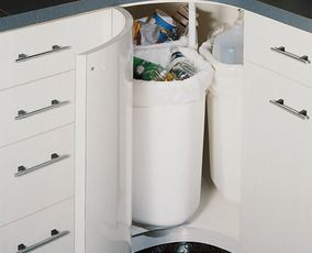 KITCHEN:  What a great idea for using that almost unusable corner in your kitchen:  recycling or trash bins on a type of lazy susan.  Separate your recycling as you go, without  3 bins sitting in your kitchen!