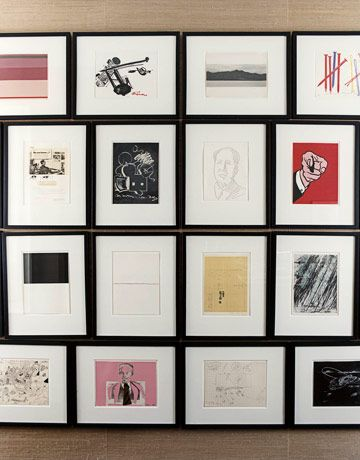 Here's an inspirational wall grouping... Identical frame designs, surrounding both vertical and horizontally oriented art, hung frame to frame. A pretty neat arrangement!