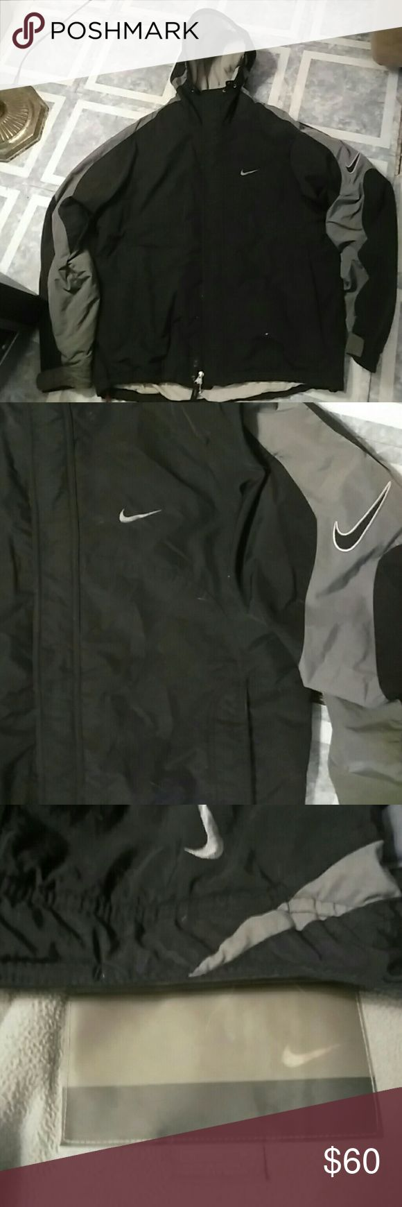 Black and Grey Nike Winter Jacket Like New Men's Medium size but I've had this forever, only worn on the more wet winter days when I was not able to wear my Faux Fur Coats as moisture always caused them to get a funky smell/feel to them. I love this coat but just way too big now to be of use wind blows up in it now so much room need to find something smaller but no hurry I've got like 7 winter coat.  I hate to see this guy go was a small fortune but can't sit on it forever!  I just love the…